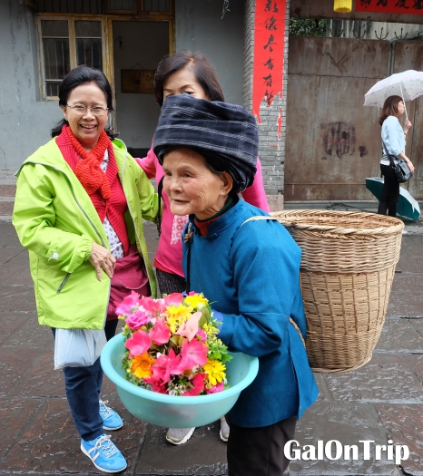 flower vendor in traditional costume