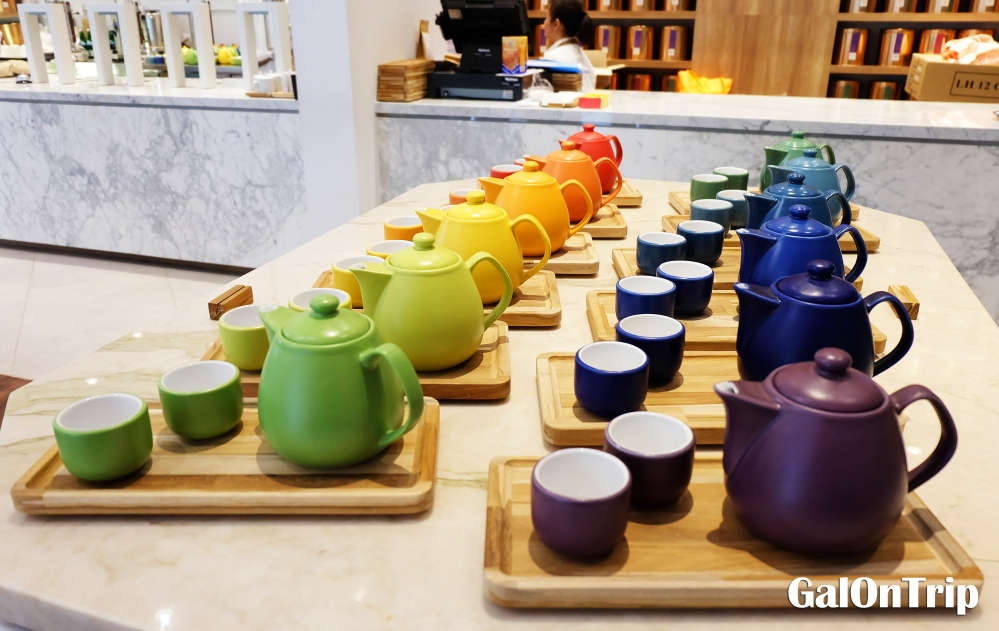 sets of teapot arranged in rainbow colours lewis & carroll